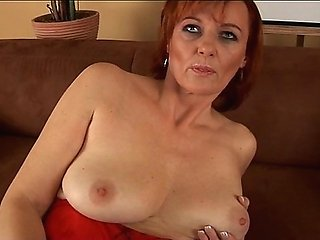 Helga is a horny granny who loves to masturbate her hairy pussy. She spent a few minutes on the couch stretching her twat apart and fingering herself