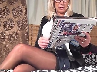 Granny do striptease in the bed