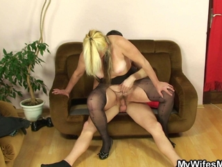 Blonde granny revitalized by riding a young dick