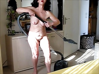 mature lady plays with her vacuum cleaner