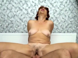Busty granny fucks surprisingly hard with a big cock