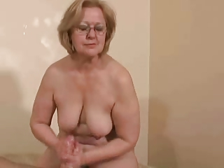 Horny busty mature jerking young cock. Amateur