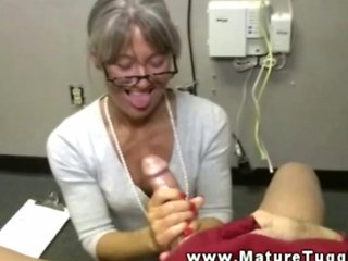 Mature granny tugging on cock for this lucky guy